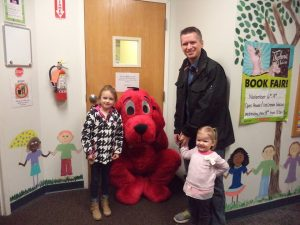 father and 2 daughters at day care